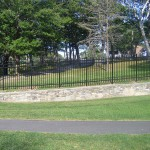 Ornamental Fence on Stone Wall